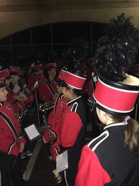 A picture of Marching Band students playing their instrument